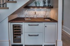 Custom wet bar built in under the stairs.