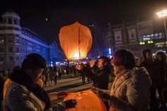 2015 | CHINA | People release sky lanterns to celebrate the New Year in Harbin, China | Fred Dufour / AFP / Getty Images