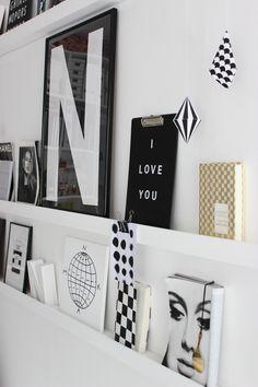 Art displayed on wall ledges