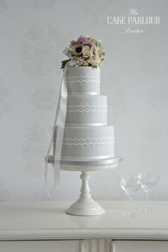 'SIMPLY ROMANTIC' Wedding Cake - Scalloped banding and delicate appliqué dots decorating a soft grey iced cake.