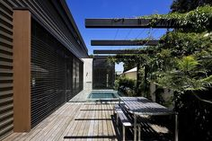 The structure emphasises low-maintenance living, from its light-filled lounge area to its pool and deck. Outdoor Furniture Australia, Teak Outdoor Furniture, Minimal Architecture, Pergola With Roof, Garden Living, Garden Pool, Garden Structures, Outdoor Areas, Pool Designs