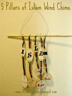 A Crafty Arab: 5 Pillars of Islam Wind Chime Tutorial.  My youngest daughter is learning about the 5 Pillars of Islam so I wanted to come up with a craft that would have her seeing them all the time.I love that she wrote out the 5 pillars herself in her handwriting. Supplies Wood beads Colored Pens Letter stickers Pliers Wood tags Wood dowel Floral wire …