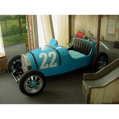 this vintage race car bed makes me think of chitty chitty bang bang. Only $20,160 for this. Oh, and the handpainted mural and slide coming out of the wall are nice touches.