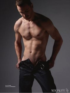 Michael Fassbender.  Please forgive the near-inappropriateness of this photo, but this man is so hot, it's ridiculous.
