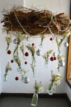 Hanging wreath by Ivy Florist, Cairns. Chincherinchee (Ornithogalum thyrsoides) and Michaelmas daisy (Aster novae belgii) suspended from a twiggy circlet. Australian Flower Industry Magazine Christmas competition