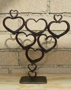 """The Valentine's Tree is forged from reclaimed angle iron. It stands a little over 9"""" tall and is 8 1/2"""" wide. By Macabee Metals"""