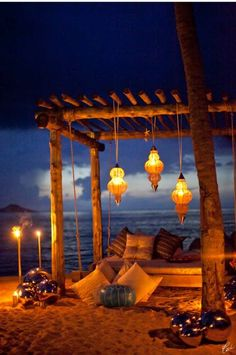 The perfect date beach setting can be as simple as a blanket, candles, and a bottle of wine or as lavish as a Hampton Hoho Beach Night Design like in this image.