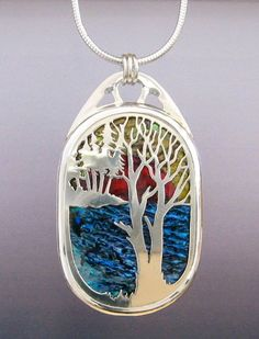 This expertly handcrafted landscape pendant is sure to please any outdoor enthusiast. I carefully design and assemble various colors of paua shell as