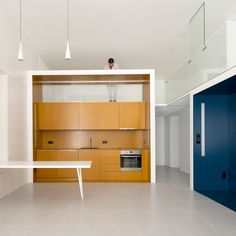 Brightly coloured niches define living spaces inside these three compact studio apartments, which Portuguese practice Waataa has created instead a former office building in Lisbon.