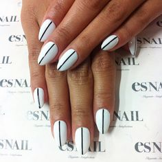The best part of this sleek, mod mani, spotted at ES Nail salon? It's super-easy to try yourself. Use two coats of a bright white polish, allow to fully dry, and then use a glossy black to make your one stripe. Worried about not getting a straight line? Masking tape will definitely help with that — just make sure your polish is completely dry before sticking it on.