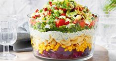 Add colour and spark to your Christmas feast with this layered pasta salad recipe.