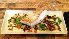 Sustainable Pan Seared Sea Bass - MSC certified sea bass with roasted wild mushrooms, brussel sprouts in a organic root vegetable succotash. Garnished with a celery root pure and horseradish froth.   #FrenchMeadowBakery&Cafe