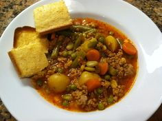 """""""Mom's Hamburger Soup"""" = Quick to mix up, makes a lot, and the Juice (instead of canned tomatoes) gives it a great flavor. More from my site Hamburger Soup is a quick and easy meal idea packed with vegetables, ground beef… Mom's Hamburger Soup Hamburger Vegetable Soup, Hamburger Soup, Veggie Soup, Vegetable Soups, Taco Soup, Beef Soup Recipes, Ww Recipes, Cooking Recipes, Healthy Recipes"""