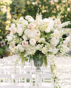 Elevated floral arrangements and a petal-filled aisle greeted the bride and groom as they entered the ceremony space where they would say… Tall Floral Arrangements, Artificial Flower Arrangements, Ceremony Backdrop, Ceremony Decorations, Church Flowers, Event Design, Elegant Wedding, Flower Pots, Wedding Flowers