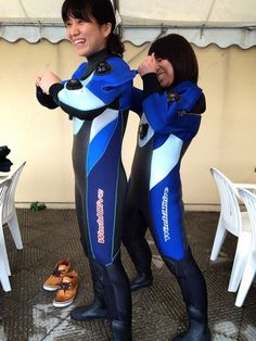 Asian girls putting on wetsuits