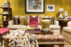 love the small pops of color in this room set against a gold wall.
