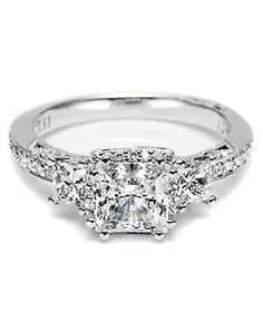 tacori. Hmmmm I have a similar style ring that is going to need a new setting soon.  I would love for my ring to look like that!!