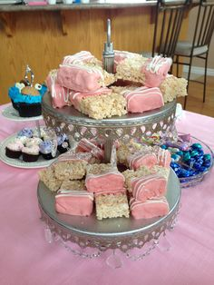 Pink and White chocolate dipped Rice Krispies squares.