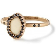 edgy.  Fossilized woolly mammoth ivory oyster ring with black diamonds