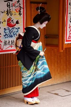 Traditional Japanese Kimono, coiffure, clogs, and makeup