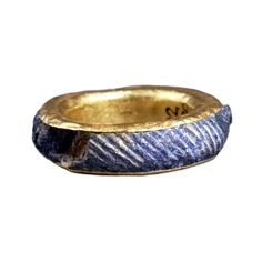 Fluted ring from the Aigina treasure, Minoan, about 1850-1550 BC  From Aigina, Aegean Sea. The Aigina treasure includes five gold rings. Four of them, inlaid with lapis lazuli, are among the most technically skillful elements in the Aigina treasure. Lapis lazuli is a rare and precious stone and came to Crete via a long trade route from Afghanistan.