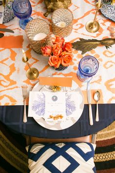 Blue complements orange for a beautiful Thanksgiving table Eclectic Dining Room Design