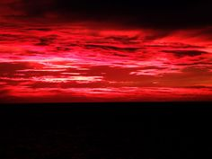 Zoomed sunset sky with red cloud flames. RAW FOOTAGE. No edit. I only add a…