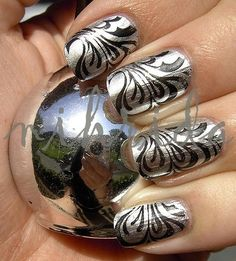 Water Marble Nails: for those of you wondering how to do this heres how: 1) paint your nails silver 2) then water marbel alternating between black and clear nail polish