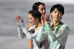 Yuzuru Hanyu of Japan and Evgenia Medvedeva of Russia applaud at an exhibiton gala on day 4 of the ISU Junior & Senior Grand Prix of Figure Skating Final at the Barcelona International Convention Centre on December 13, 2015 in Barcelona, Spain.