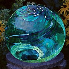 glow crystals embedded inside hand blown globe absorbs light energy from any light source and emits soothing green glow for hours after dusk