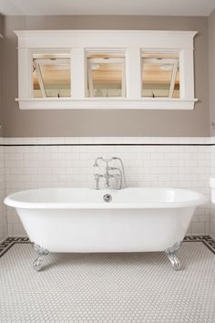 claw foot tub and floor tile border