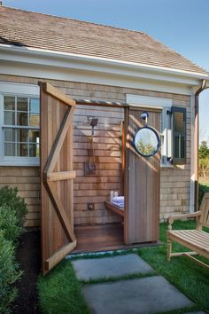 A concrete path from the HGTV Dream Home 2015 backyard patio leads the the mahogany outdoor shower.