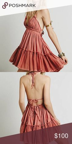 Free People 💕 100 degree dress Gorgeous free people 100 degree dress in the sold out color Wild Rose, a beautiful dusty rose color. Super feminine and flattering! Ties around the neck and back. Excellent condition! Size medium.   ⭐️ Top-rated seller!  💌 All items ship same or next day  🎀 Free stickers with purchase 📩 All reasonable offers considered!  💖 15% discount on Bundles  Will add photos shortly! Free People Dresses Mini