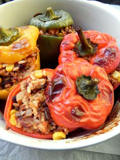 Vegan Stuffed Peppers stuffed with a hearty and filling mixture of tomatoes, wild rice, beans, vegetables and corn. A healthy, gluten free + delicious meal!