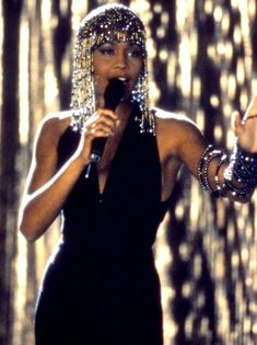 Whitney Houston...when I hear my daughter sing I will always love you, I weep every time!  Such a beautiful voice!