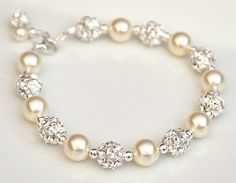 $63 Pearl Rhinestone Bracelet, Rhinestone Pearl Wedding Bracelet. Bridal Bracelet, Ivory Pearl Bracelet. Bridesmaid Bracelet. Wedding Jewellery    Add it to your favorites to revisit it later.  Pearl Rhinestone Bracelet, Rhinestone Pearl Wedding Bracelet. Bridal Bracelet, Ivory Pearl Bracelet. Bridesmaid Bracelet. Wedding Jewelery @Cassie Blue