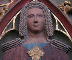 A lady at the cathedral in Frankfurt am Mein, Germany, circa 1370