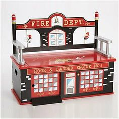 Firefighter Toy Box Bench by Levels of Discovery. $199.95. LOD20036 Features: -Plenty of storage.-Slow-closing metal safety hinge.-Large sliding door so fire trucks and other vehicles can drive right up the ramp and into the fire station!.-Each piece is independently tested to meet all safety requirements and standards of the CPSC. Dimensions: -Bench Height: 13''.-Overall dimensions: 26''H x 32''W x 15''D.