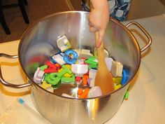 """While making dinner, let your preschooler make some """"alphabet soup"""" at the counter. Here's how we play this super simple letter sounds game..."""
