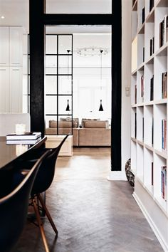 Everything about this space is perfect—the window pane doors, flooring, shelving / #interior #space #decor