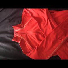 Nike Dri Fit HalfZip Nike dri fit half zip, worn a few times. Stretchy orangey red color Nike Tops