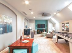 Family room with touches of turquoise blue (Karista Hannah and Lauren Harp, via House of turquoise)