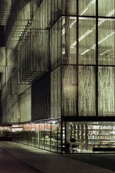 Wiel Arets - Utrecht University Library, 2004.The library's glass façade at night.