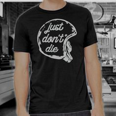This Just Dont Die Vintage Motorcycle Shirt celebrates the retro, hands-on approach of vintage motorcycle riders with super-soft printing on an ultra-comfy shirt. Ride the bike, wrench the bike, ride the bike again, Just Dont Die. *We love female motorcycle riders too! WANT THIS IN A WOMENS CUT T-SHIRT? EMAIL ME AND LET ME KNOW!  Pre-Shrunk Comfy Tee  - 100% Pre-Shrunk Cotton - no more laundry day surprises  - Double-needle stitched sleeves and bottom hem - less rogue loose threads going…