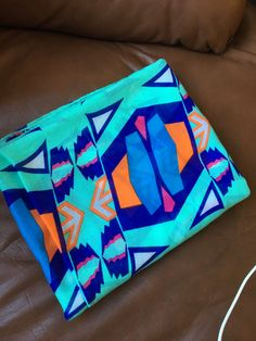 Hi StitchFix! This is one of my scarves: geometric with bright green-teal and a darker blue teal and some cobalt. Also smaller amounts of white, orange and bright pink.