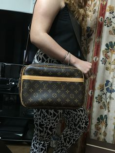 Pre loved authentic LOUIS VUITTON Monogram Reporter PM serial number #SP0013 This messenger bag is crafted of iconic brown and gold Louis Vuitton monogram coated canvas. Featuring two compartments both secured with double zippers and an open patch pocket in front and adjustable nylon cross-body shoulder strap. The spacious interiors are lined in beige fabric with two interior flat pockets. Bag is in very good condition.  Selling for $650