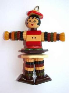 Bakelite button doll