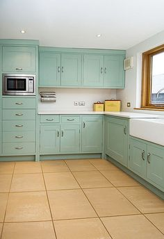 Turquoise kitchen cabinets with black backsplash and counters and ...