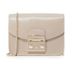 Metropolis mini cross body bag by Furla. A petite Furla cross body bag in rich leather. A polished push lock fastens the top flap. Faille lined, 1 pocket inte...
