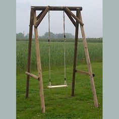 Wooden Garden Single Swing --- since our tree limb isn't going to last! Backyard Swing Sets, Diy Swing, Backyard For Kids, Outdoor Wooden Swing, Wooden Swings, Small Swing Sets, Swing Set Plans, Build A Frame, Backyard Playground